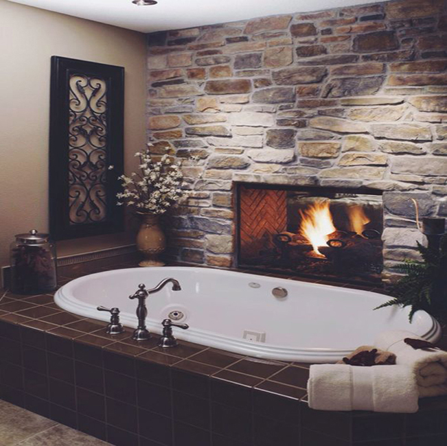 romantic-bathroom-fireplace-with-stone-wall