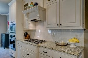 White Washed Kitchen with Granite Countertop