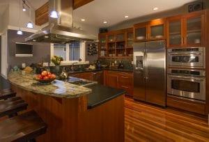 Empty Kitchen with Black Quartz Countertops