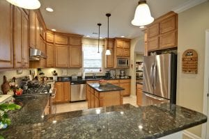 spacious modern kitchen with maple cabinets and granite