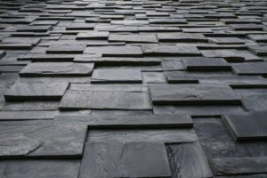 Pieces of stone wall, for background or texture , pattern gray of modern style design , real stone wall with black.